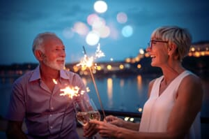 Retired couple with sparklers at night