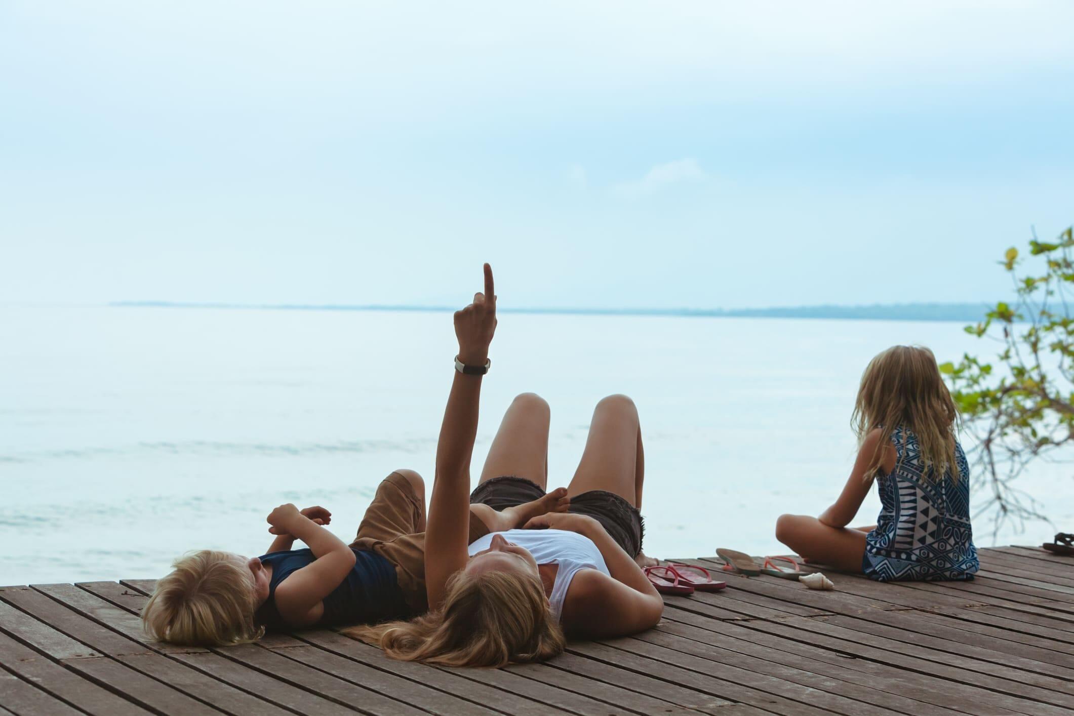 Family relaxing on dock