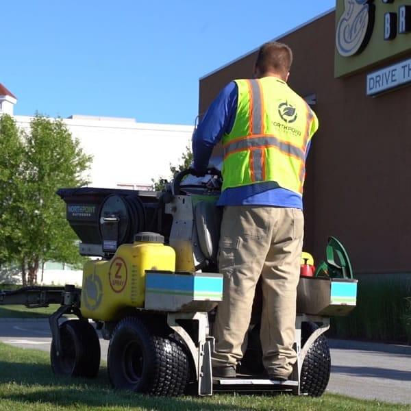 Lawn fertilization machine being run by North Point employee