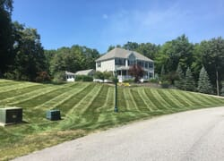 Upscale home with striped lawn mowing