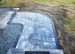 New stone walkway that turns a corner