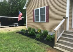 Small planting bed in front of New Hampshire home